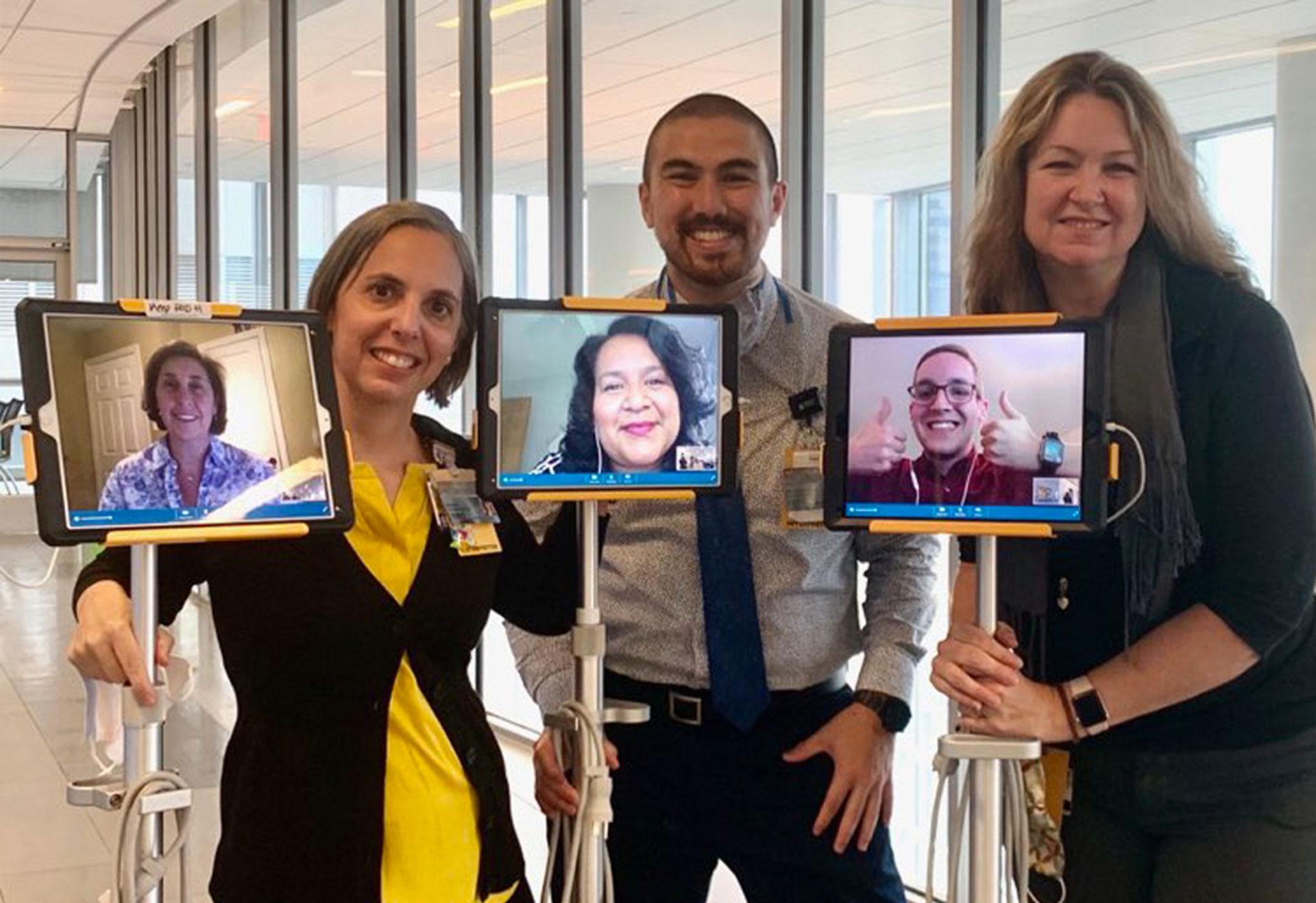 vcu staff with staff members using Martti to communicate