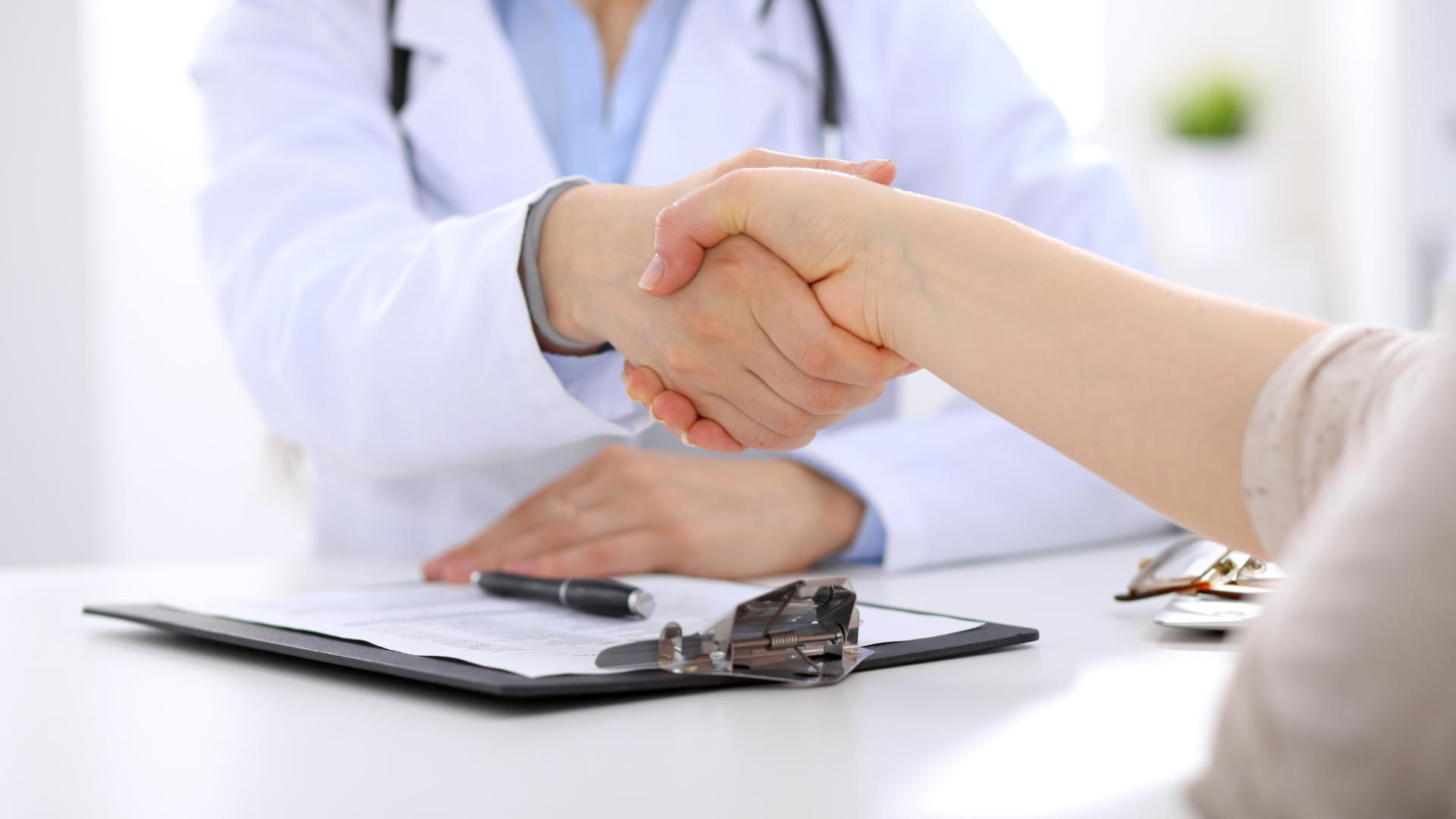 handshake demonstrating trust between doctor and patient